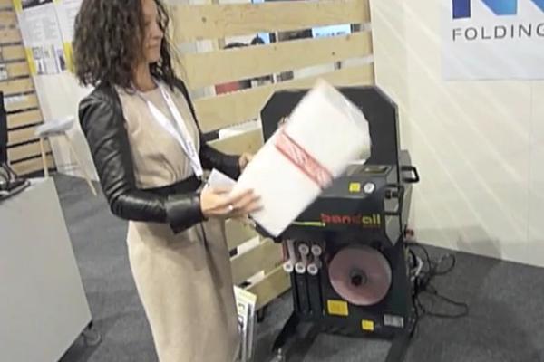 Voula showcasing an ICEE folding box